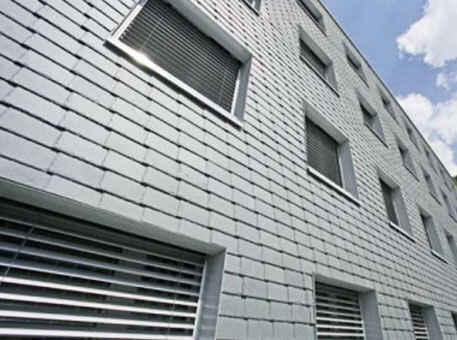 Фото 3. Фасад из сланца на высотных зданиях